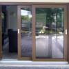 Porta finestra scorrevole in pellicola legno, ideale per terrazzi e giardini